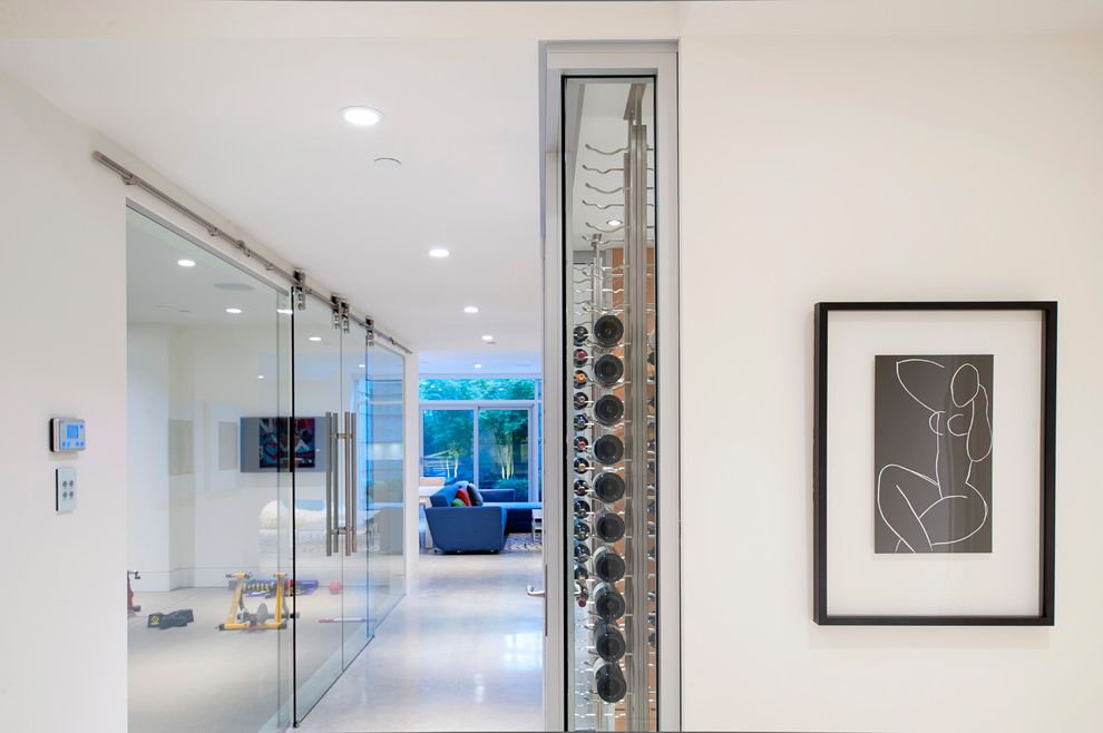 Wine and Design Richmond Va   Contemporary Hall  and Clear Wine Cellar Wall Glass Interior Doors Glass Wine Storage Hall Horizontal Wine Rack Picasso Picasso Art Sliding Glass Door White Floor Wine in Hall Wine Rack Workout Area Workout Room
