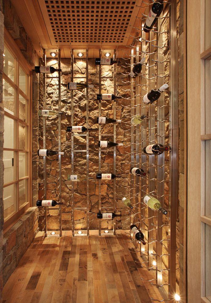 Wine Cellar Los Gatos with Beach Style Wine Cellar  and Built in Storage Rustic Stone Wall Up Lighting Vertical Storage Wine Racks Wine Storage Wood Flooring