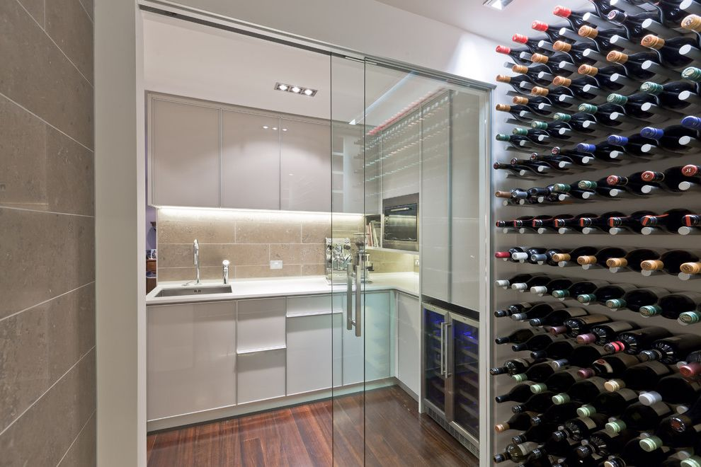 Wine Refrigerator Small with Contemporary Wine Cellar Also Ceiling Lighting Glass Doors Kitchen Minimal Recessed Lighting Under Cabinet Lighting White Cabinets White Kitchen Wine Racks Wine Refrigerator Wine Storage Wood Flooring