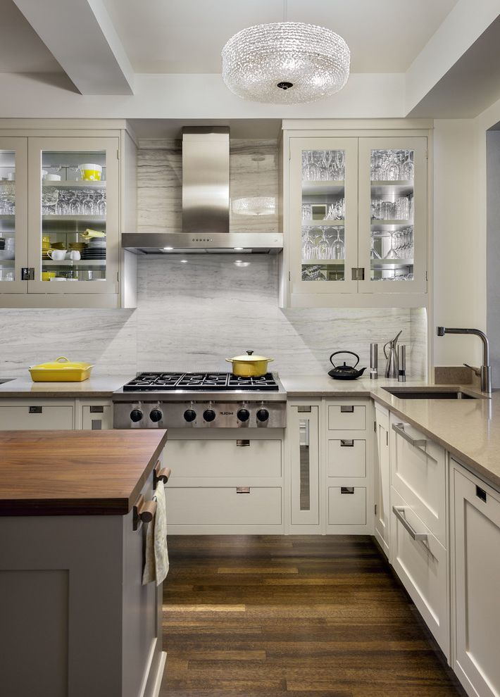 Wolf Gas Stove Top with Transitional Kitchen Also Butcher Blck Island Glass Cabinet Doors Gray Countertop Pendant Lights Under Cabinet Lighting
