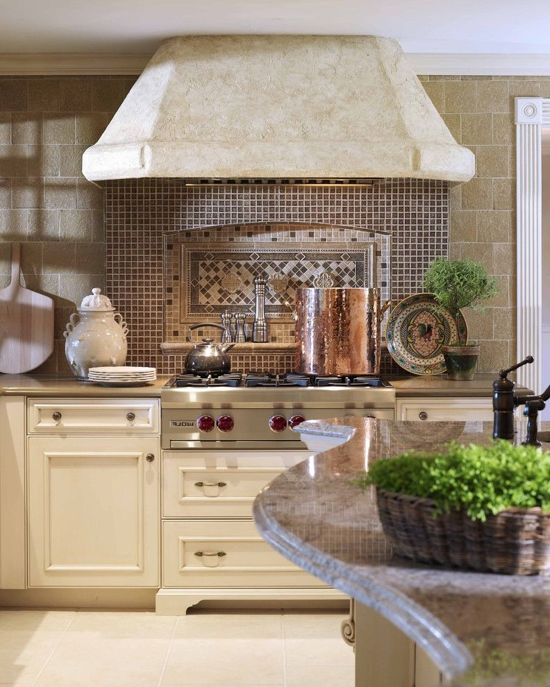 Wolf Stoves   Traditional Kitchen  and Built Ins Copper Pots Kitchen Hardware Kitchen Island Kitchen Shelves Mosaic Tiles Range Hood Stainless Steel Appliances Tile Backsplash Tile Flooring Wall Tile Design White Cabinets White Kitchen Wood Cabinets