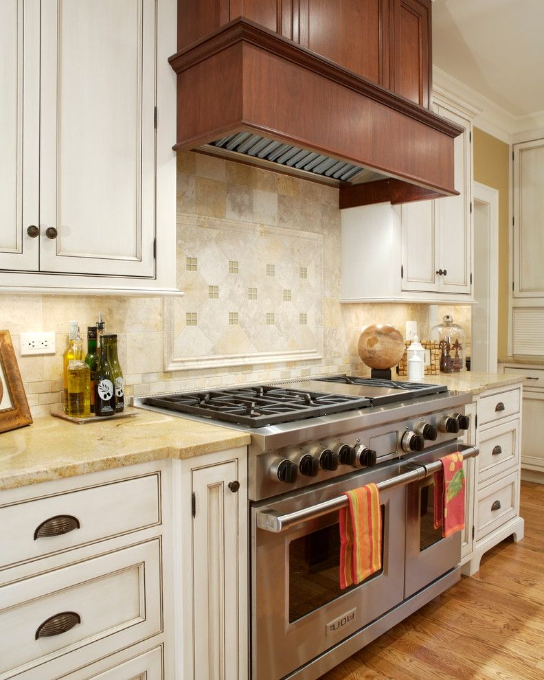 Wolf Stoves with Traditional Kitchen Also Beige Countertop Cup Pulls Recessed Panel Cabinets Under Cabinet Lighting Wood Hood