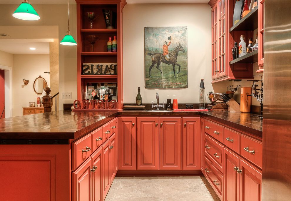 Wolfe and Associates with Traditional Home Bar  and Bar Sink Basement Kitchen Crown Molding Custom Home Green Pendnat Lights Horse Artwork New Home Construction Open Shelves Pendant Lights Red Cabinets Wood Countertop