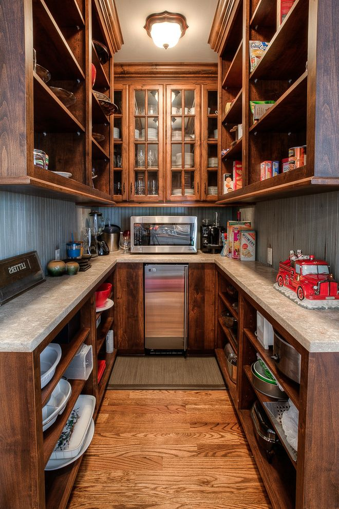 Wolfe and Associates with Traditional Kitchen  and Beadboard Backsplash Crown Molding Custom Home Dish Storage Exposed Shelves Glass Paned Cabinet Doors Glassware Storage Mini Refrigerator New Home Construction Pantry Walk in Pantry