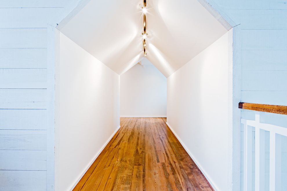 Wood Floor Buckling with Rustic Hall  and Ceiling Lighting Minimal Monochromatic Rustic Sloped Ceiling Track Lighting Vaulted Ceiling White Wood Wood Flooring Wood Siding Wood Trim