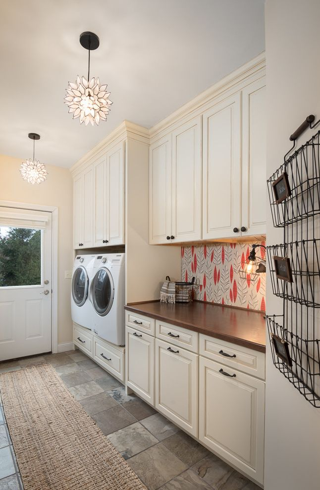 Wood Look Countertops   Farmhouse Laundry Room  and Beige Raised Panel Cabinets Brown Countertop Brown Tile Floor Feather Pendant Light Floral Pendant Light Red and White Backsplash