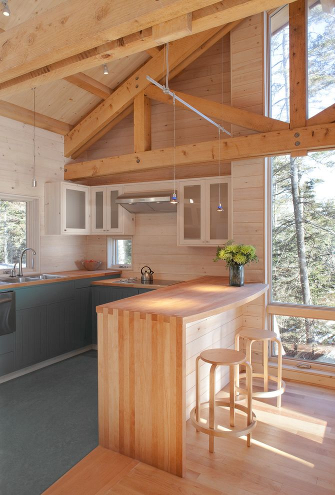 Wood Look Countertops with Rustic Kitchen Also Beams Counter Stools Frosted Glass Glass Front Cabinets Knotty Pine Natural Pine Painted Cabinets Pendant Lights Stainless Steel Vaulted Ceilings White Washed Wood