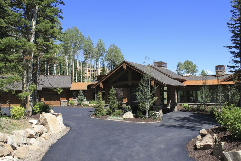 Woodland Park Lodges   Rustic Exterior Also Boulders Carport Circular Driveway Entrance Entry Evergreen Trees Lodge Metal Roof Rocks Rustic