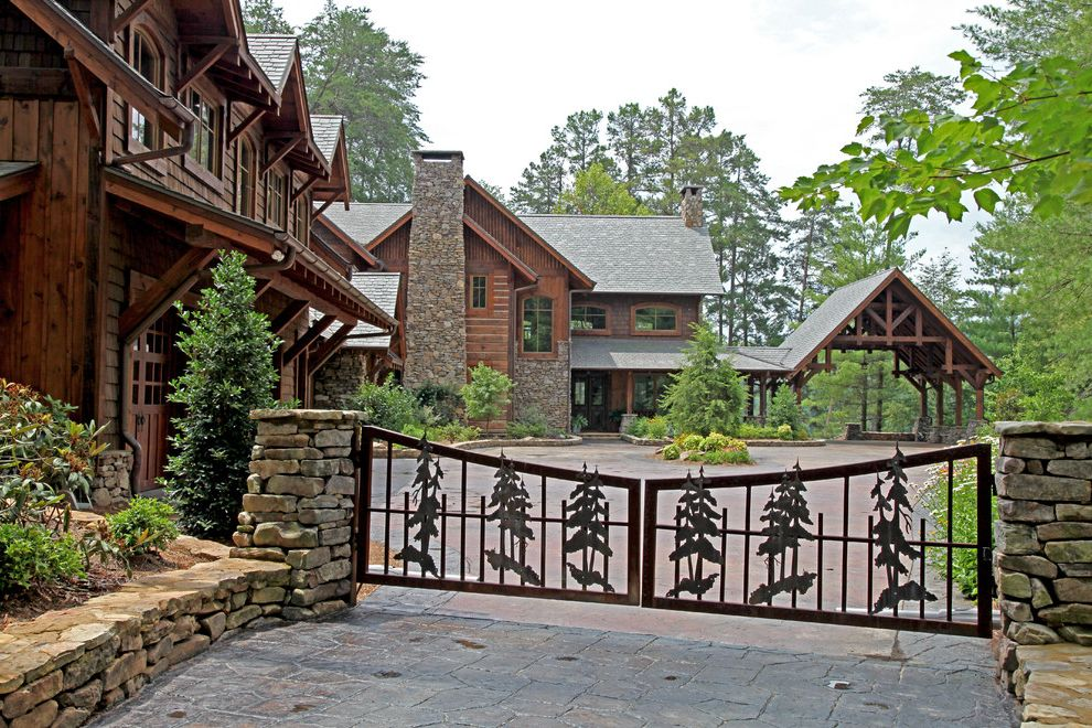 Woodland Park Lodges   Traditional Exterior  and Board and Batten Siding Car Port Circular Driveway Gable Roof Iron Entry Gate Knee Brace Log Siding Pavers Porch Rafter Tails Shingle Style Stacked Stone Retaining Wall Stone Chimney Stone Siding