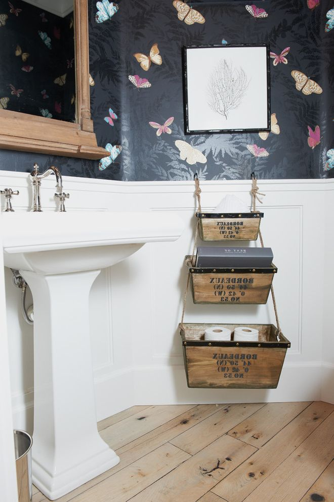 Wreath Storage Box with Eclectic Powder Room Also Baskets Bathroom Storage Butterfly Wallpaper Framed Art Mirror Pedestal Sink White Wainscoting Wood Floor