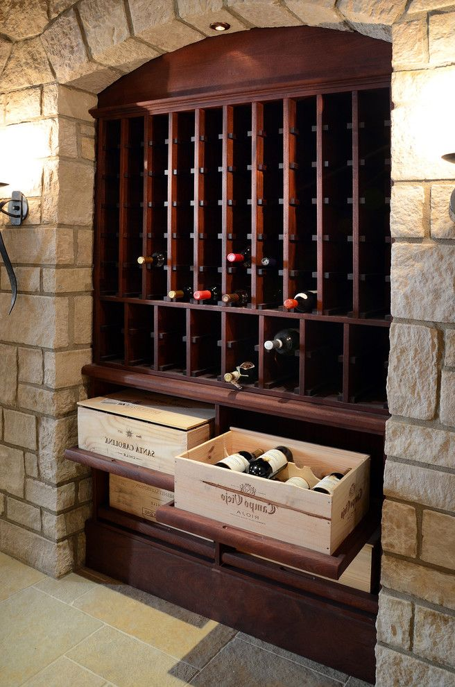Wreath Storage Box with Traditional Wine Cellar  and Built in Wine Storage Custom Woodwork Dark Stained Wood Pull Out Shelves Recessed Lighting Stone Arch Stone Floor Wall Sconce Wine Crates