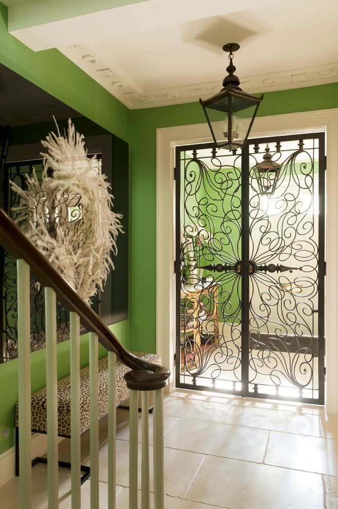 Wrought Iron Storm Doors with Eclectic Entry and Art Nouveau Inspired Door Ceiling Decoration Cheetah Print Bench Coach Lamp Pendant Entry Bench Green Walls Metal Door Metal Filagree Ornate Trim Photorealism White Trim