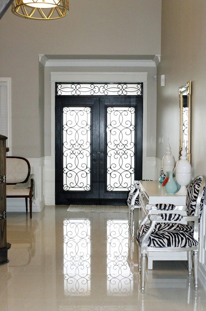 Wrought Iron Storm Doors with Eclectic Hall and Ceiling Light French Settee Gold Mirror Silver Leaf Chair Tile Tiled Floor Wainscoting Wrought Iron Door Zebra Print Zebra Silver Leaf Chair