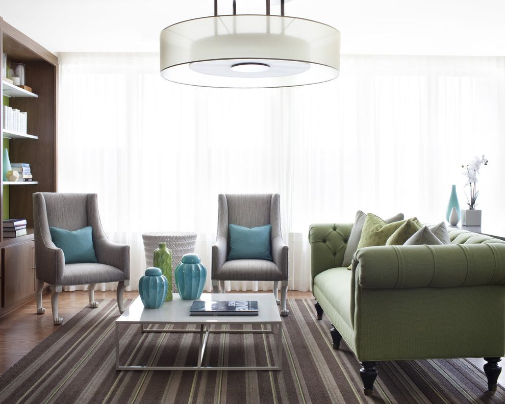 Www Bobs Furniture   Contemporary Living Room Also Built in Bookcase Deep Button Footed Furniture Glass Wall Green Green Chesterfield Sofa Light Blue Open Shelves Square Coffee Table Striped Area Rug White Curtains White Stool Side Table Wood Flooring