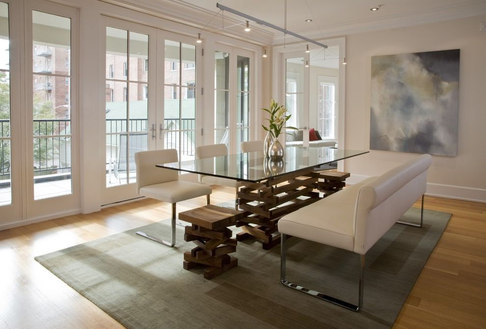 Www.clickerproducts.com with Contemporary Dining Room  and Area Rug Balcony French Doors Glass Top Table Painting Suspension Light White Baseboard White Leather Bench Seat White Leather Dining Chairs Wood Floor