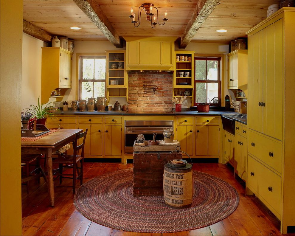 Yellow Brick Pizza   Farmhouse Kitchen  and Black Countertop Braided Rug Brick Backsplash Bright Yellow Exposed Beams
