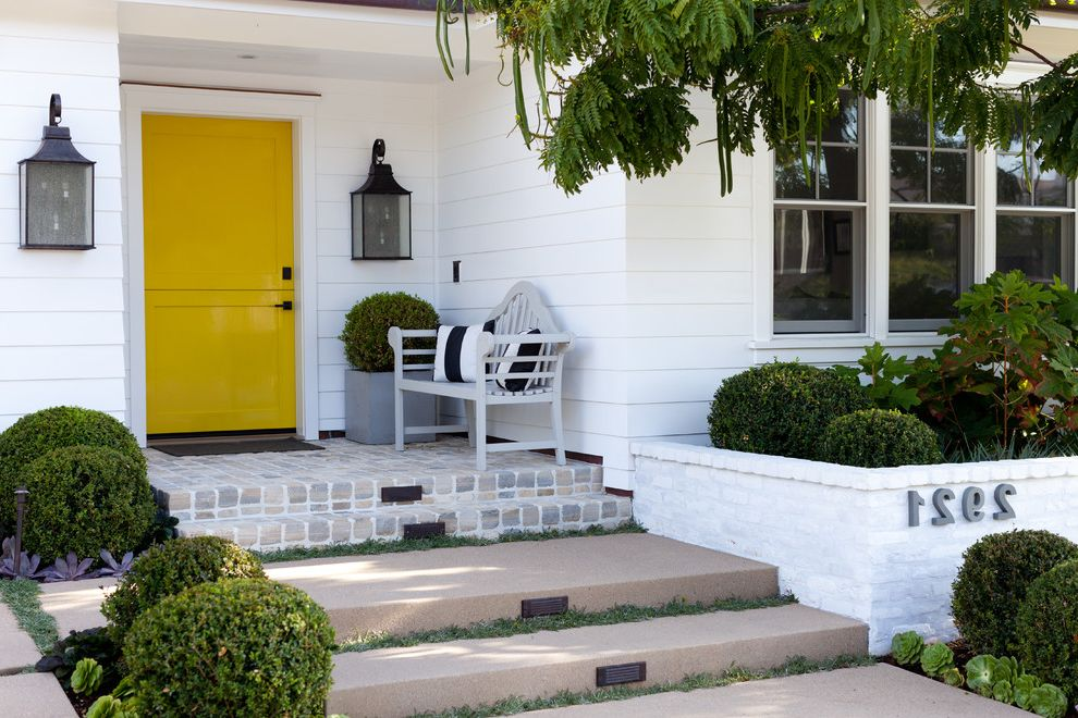 Yellow Brick Pizza   Traditional Entry  and Covered Entry Curb Appeal Entry Bench Exterior Front Entry Hardscape Landscape Lantern Wall Sconce Painted Brick Pillows Planting Beds Steps Topiary White Lap Siding Whitewashed Brick Yellow Dutch Door