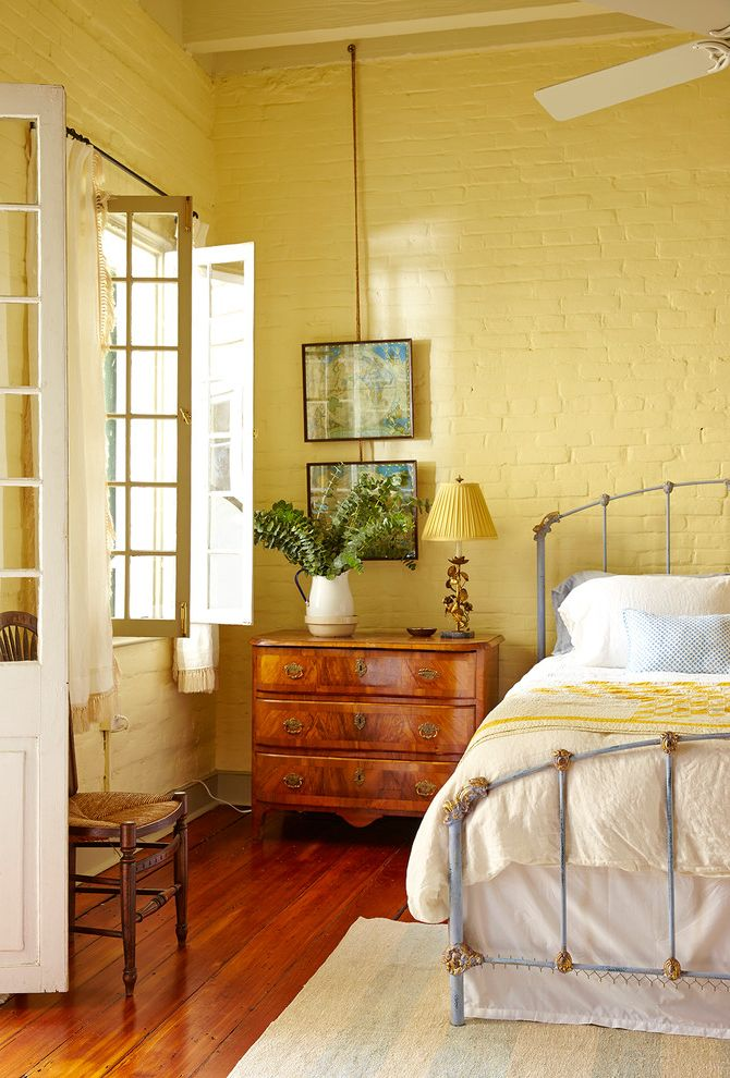 Yellow Brick Pizza with Shabby Chic Style Bedroom Also Beamed Ceiling Brick Wall Ceiling Fan High Ceiling Metal Bed Frame White Bedding Yellow Painted Brick