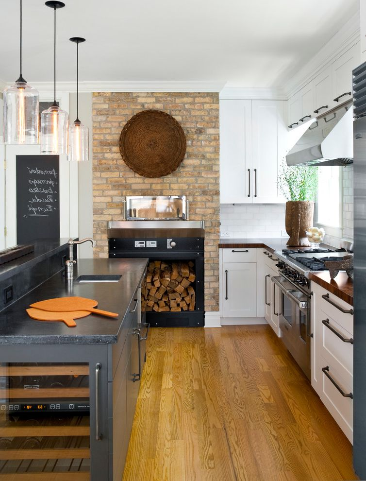 Yellow Brick Pizza with Transitional Kitchen Also Black Countertop Brick Fireplace Chalkboard Door Chalkboard Paint Glass Pendant Lights Wine Refrigerator Wolf Appliances Wood Burning Pizza Oven Wood Countertops