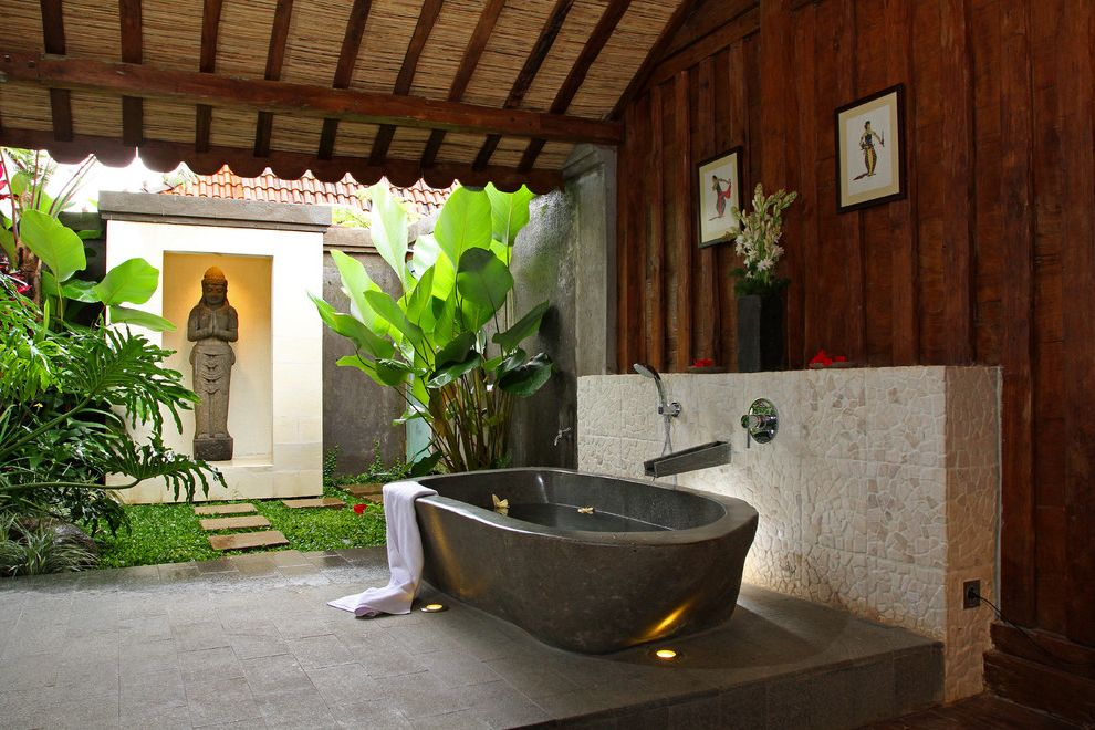 Zen Spa Quincy with Tropical Bathroom Also Bathroom Courtyard Freestanding Tub Garden Bathroom Indoor Outdoor Javanese Outdoor Bathroom Sloped Ceiling Stone Wall Uplighting Vaulted Ceilings Wood Paneling