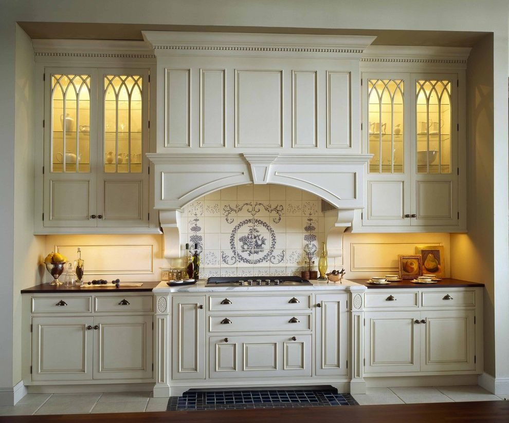 Zephyr Range Hood Reviews   Traditional Kitchen Also Applied Molding Arch Over Range Backsplash Beaded Trim Blue and White Bump Out Cabinets Ceramic Tile Cooktop Corbels Cream Crown French Country Glass Front Door Gothic Arch Ivory