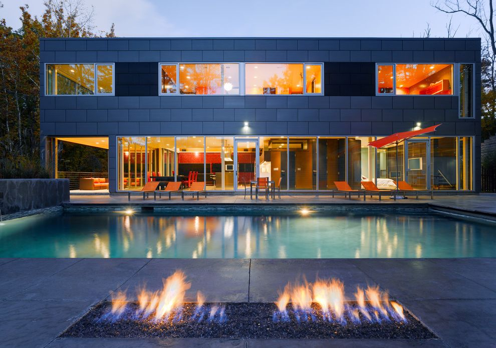 Zinc Siding   Industrial Pool  and Aluminum Windows Automatic Pool Cover Exterior Fire Pit Flat Roof Floor to Ceiling Windows Linear Burner Outdoor Fireplace Rectangular Pool Water Feature Wooded Site Zinc Cladding
