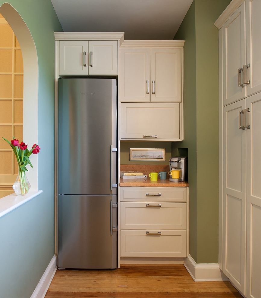 23 Inch Wide Refrigerator with Transitional Kitchen  and Archway Baseboards Green Walls Small Kitchen Stainless Steel Appliances White Kitchen White Wood Wood Cabinets Wood Flooring