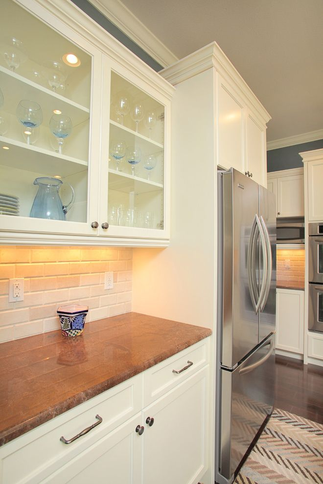 33 Inch Wide Refrigerator Bottom Freezer   Traditional Kitchen Also Area Rug Brown Frame and Panel Cabinets Glass Panel Cabinets Granite Counters Gray Stainless Steel Appliances Subway Tile Tile Backsplash White Paired Trim Wood Floor