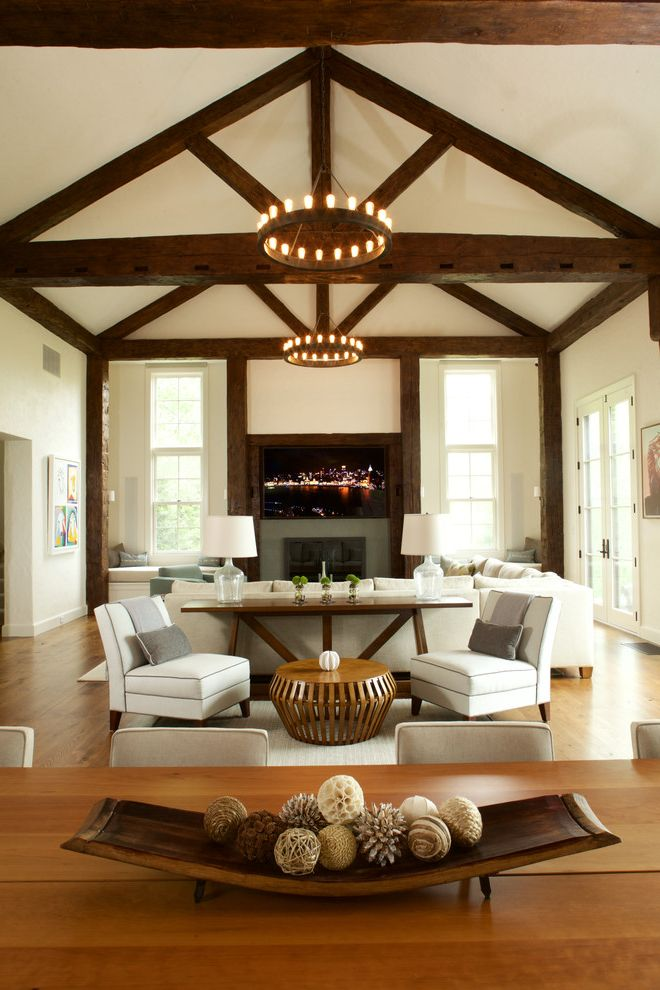 72 Inch Sofa Table with Farmhouse Family Room  and Chandeliers Exposed Beams Multiple Seating Areas Sectional Sofas Tv Over Fireplace Vaulted Ceiling