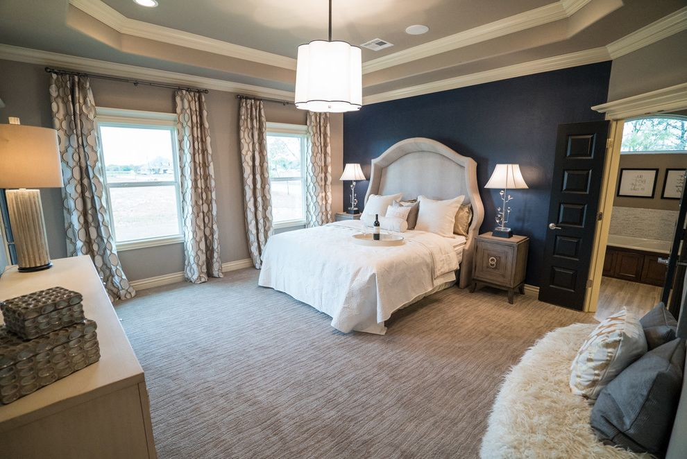 Allenstyle Homes   Modern Bedroom  and Master Bedroom Modern Light Fixture Navy Accent Wall Silver Curtains White Bedding