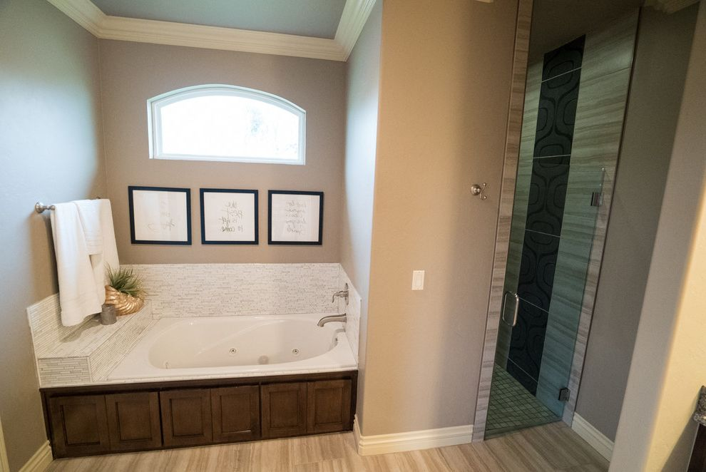 Allenstyle Homes with Modern Bathroom  and Arched Window Glass Shower Door Gold Decorations Jetted Tub Walk in Showers White Vase