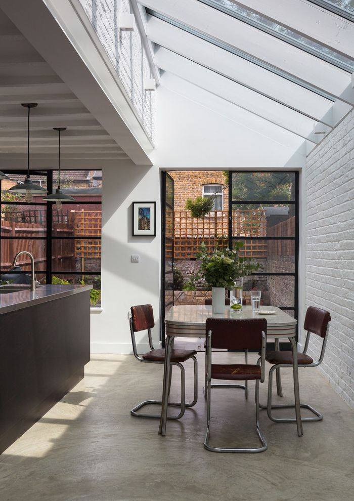 American Thermal Windows   Contemporary Dining Room  and Concrete Floor Exposed Beams Exposed Brick Glass Roof Painted Brick Skylights Stainless Steel Worktop