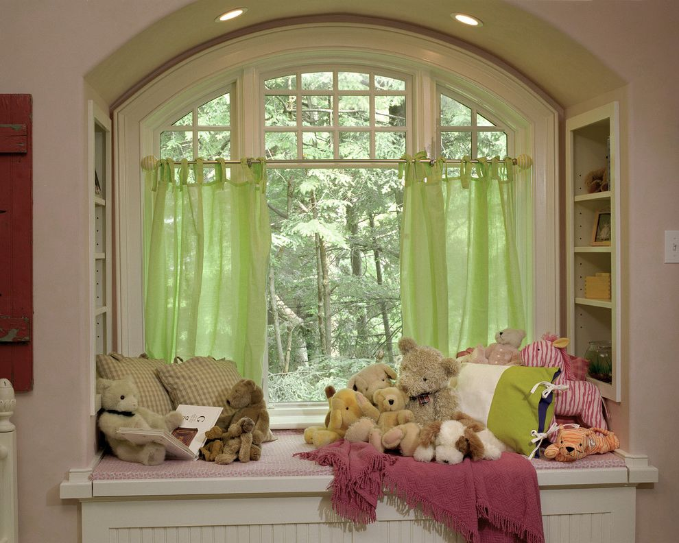American Thermal Windows   Traditional Kids  and Arch Bookcase Built in Ceiling Lighting Curtains Drapes Pink Wall Playroom Recessed Lighting Stuffed Animals White Wood Window Covering Window Seat Wood Trim