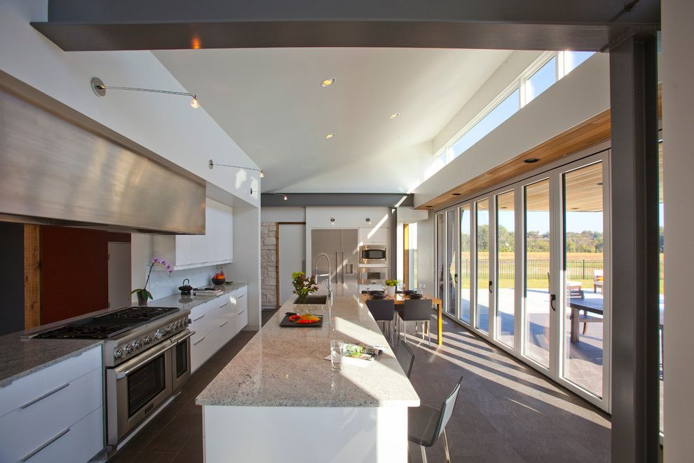 Amish Sheds Long Island with Modern Kitchen Also Clerestory Window Edge Pulls Glass Doors Gray Countertop Island Seating Island Sink Kitchen Island Midcentury Modern Open Concept Open Floor Plan Raked Ceiling Slanted Roof