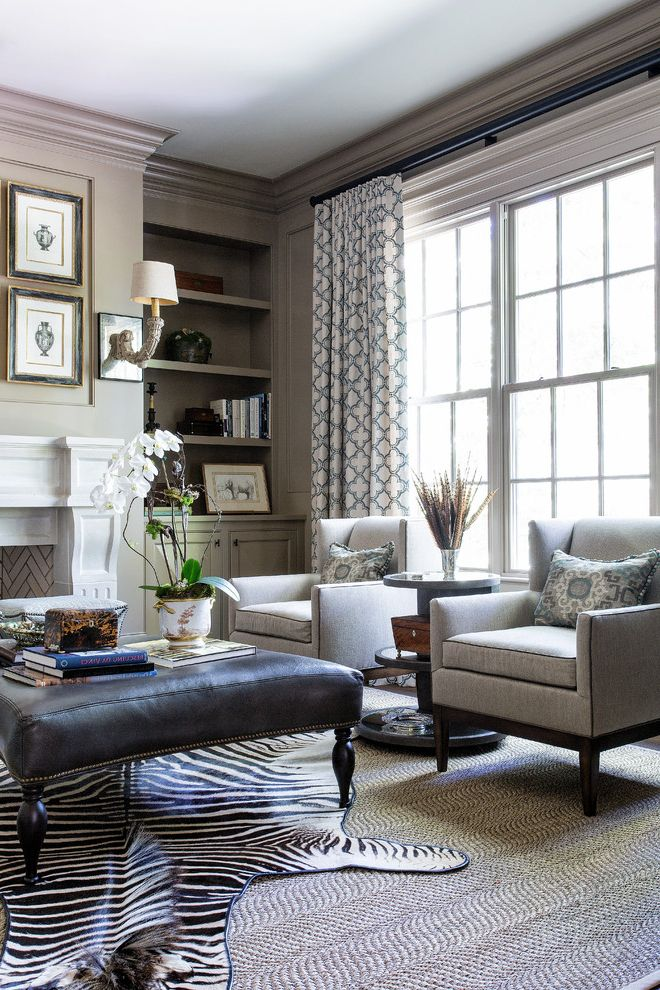 Animal Control Denver   Traditional Living Room Also Framed Art Gray Armchair Open Shelves Patterned Curtains Upholstered Ottoman Wall Sconces Zebra Rug