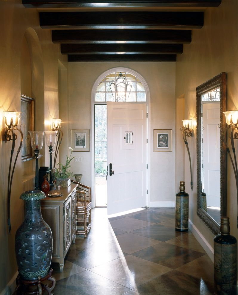 Arched Floor Mirror   Traditional Entry  and Arched Doorway Artwork Concrete Floors English Country Entry Table Exposed Beams Harlequin Floor Pattern Lutyens Sconce Textured Walls Transom Wall Art Wall Decor Wall Lighting