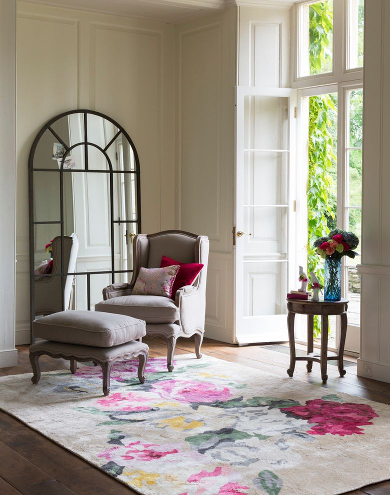 Arched Floor Mirror   Traditional Living Room  and Arched Floor Mirror Double Doors Filou French Footstool Floral Area Rug Formal French Doors Glass Front Doors Gray Armchair High Ceilings Louis French Armchair Ottoman Transom Windows Wainscoting