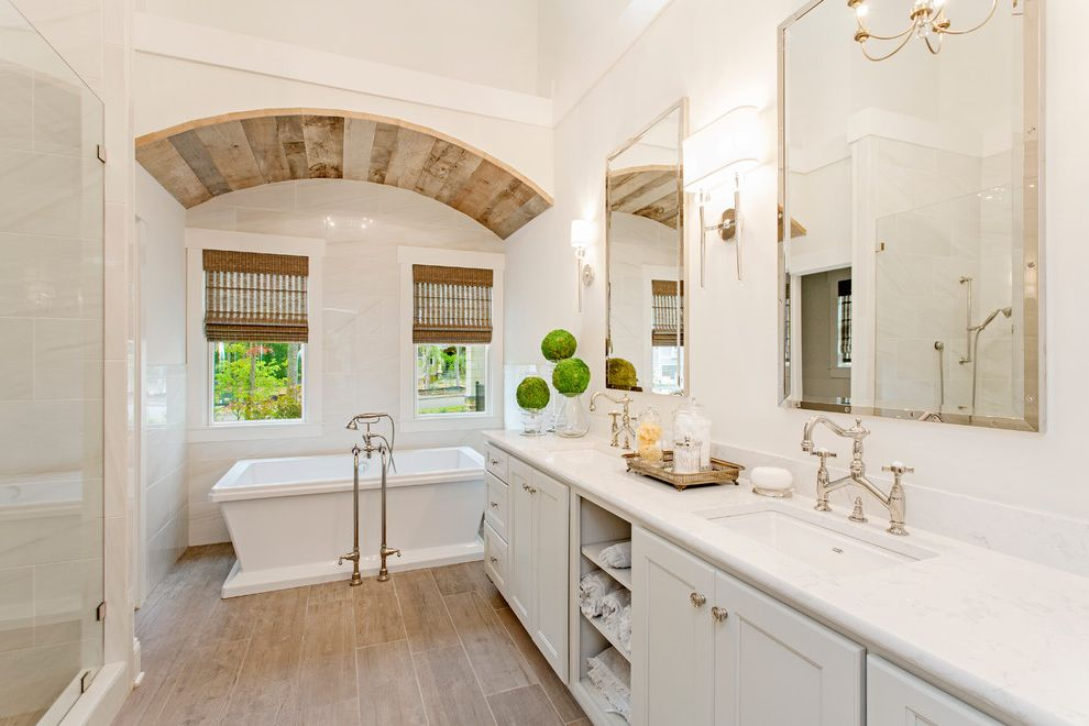 Arched Floor Mirror with Transitional Bathroom Also Arched Ceiling Freestanding Tub Hardwood Floors His and Hers Vanity Rustic Modern Bathroom Silver Border Mirror Small Topiary Tree White Bathroom White Cabinets