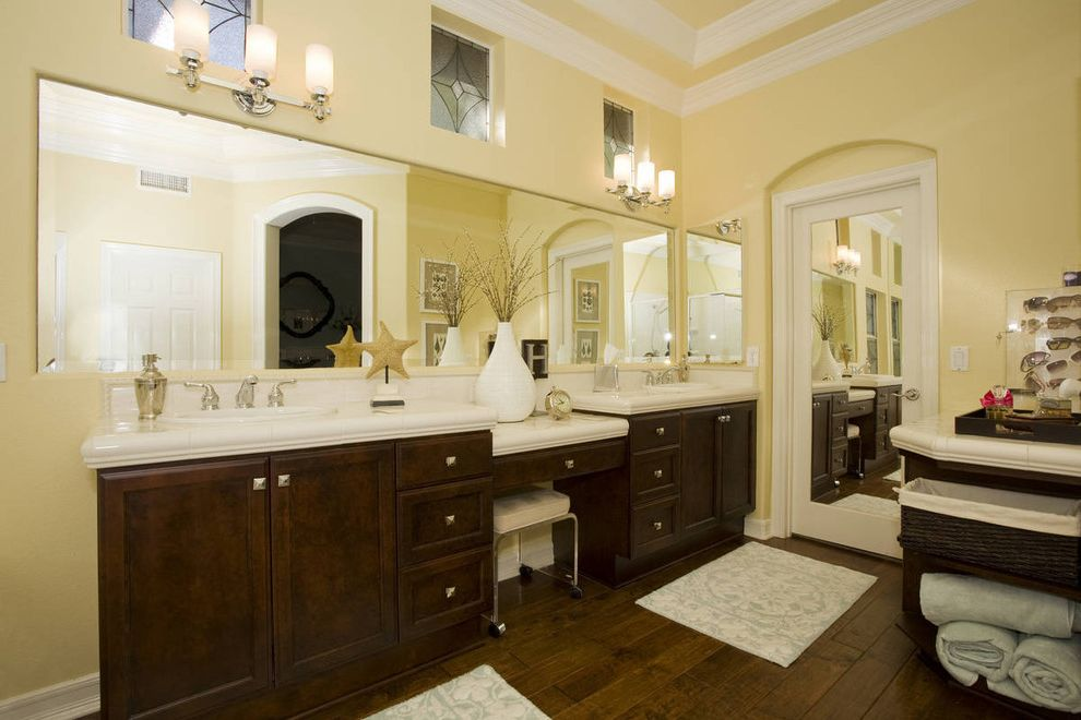 Arched Floor Mirror with Transitional Bathroom  and Arched Doorway Crown Molding Dark Stained Wood Double Sinks Leaded Glass Mirror Vanity Stool Wall Sconce White Counters Wood Floor