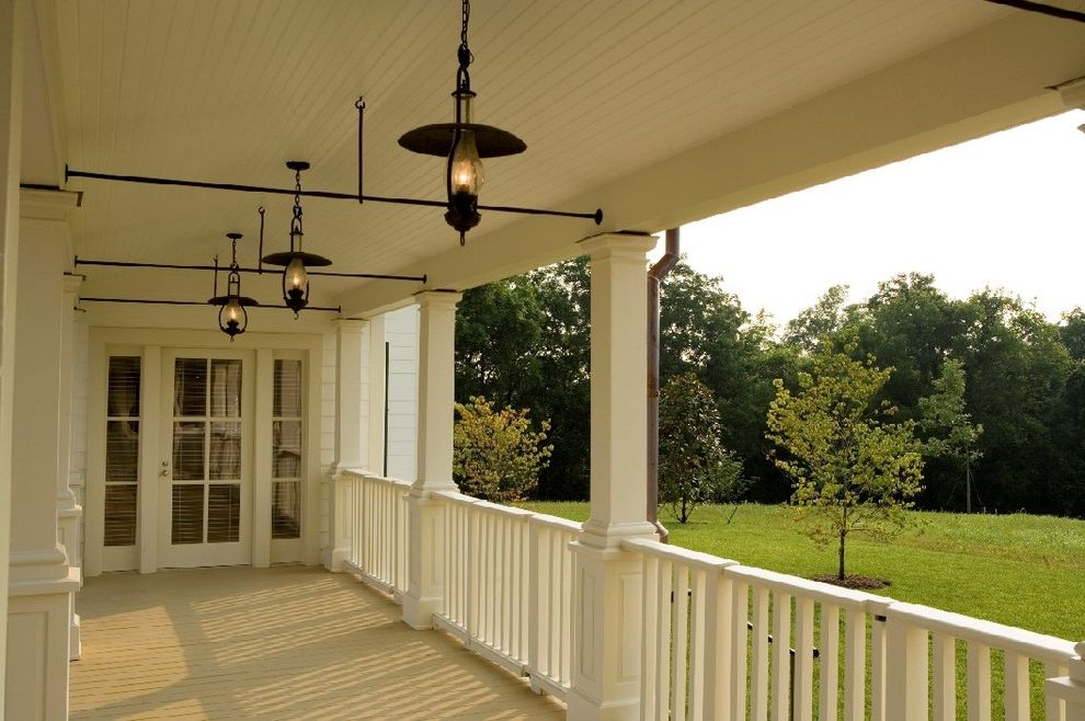 Back Porch Additions with Farmhouse Porch  and Beadboard Classical Architecture Covered Porch Farm French Door Lanterns Nashville Architect Painted Ceiling Pasture Porch Timbers White Painted Wood