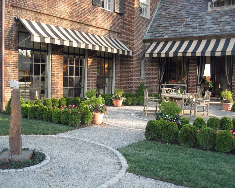 Back Porch Additions with Traditional Landscape Also Brick Facade Brick House Fois Bois Furniture Grass Gravel Lawn Outdoor Room Patio Sculpture Shrubs Striped Awning Turf