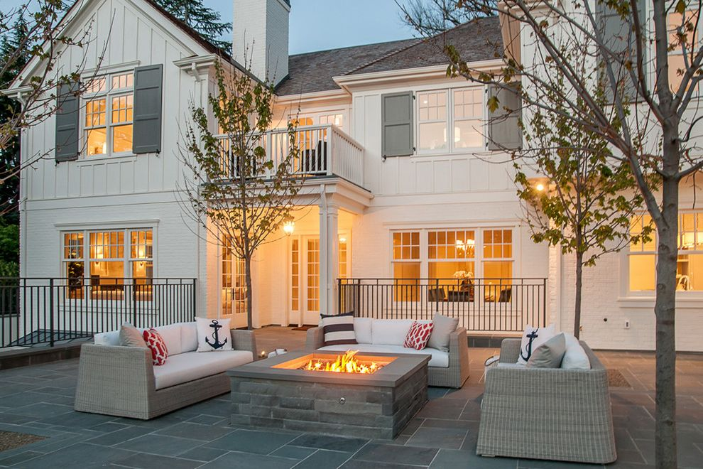 Baers Furniture Orlando   Farmhouse Patio Also Balcony Board and Batten Siding Deck Fire Pit Gray Shutters Outdoor Lighting Shingle Roof White Railing