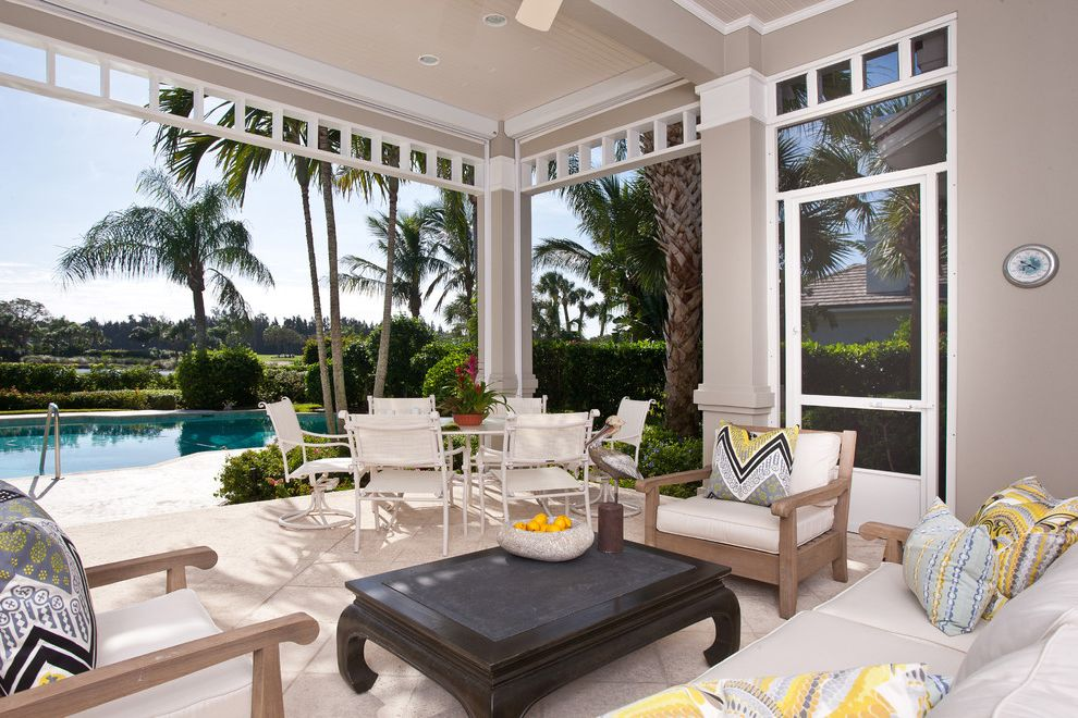 Baers Furniture Orlando   Tropical Patio Also Bead Board Beige Ceiling Fan Covered Patio Gray Outdoor Dining Palm Trees Pool Printed Pillows Seat Cushions Teak Lounge Furniture Tile Floor Yellow