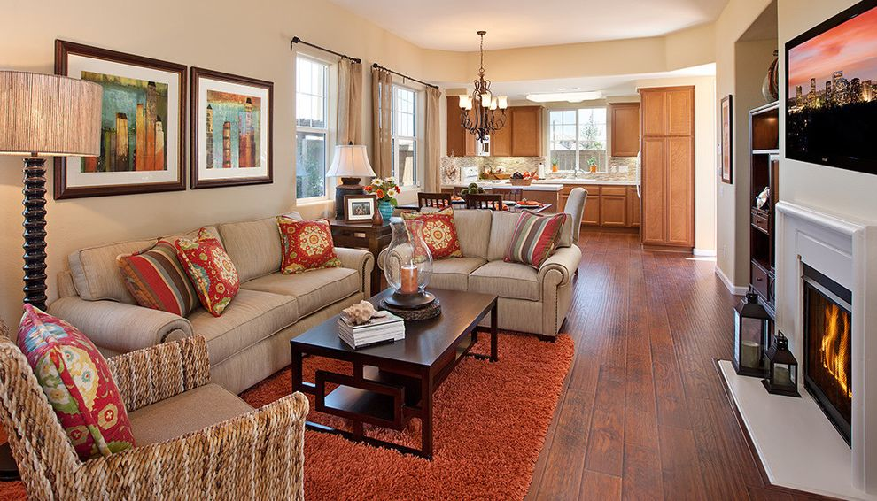 Baers Furniture Orlando with Contemporary Living Room Also Alcove Artwork Chandelier Coffee Table Dark Stained Wood Fireplace Floor Lamp Great Room Hurricane Lantern Kitchen Orange Rug Pillows Table Turned Wood Wood Floor Woven Arm Chair