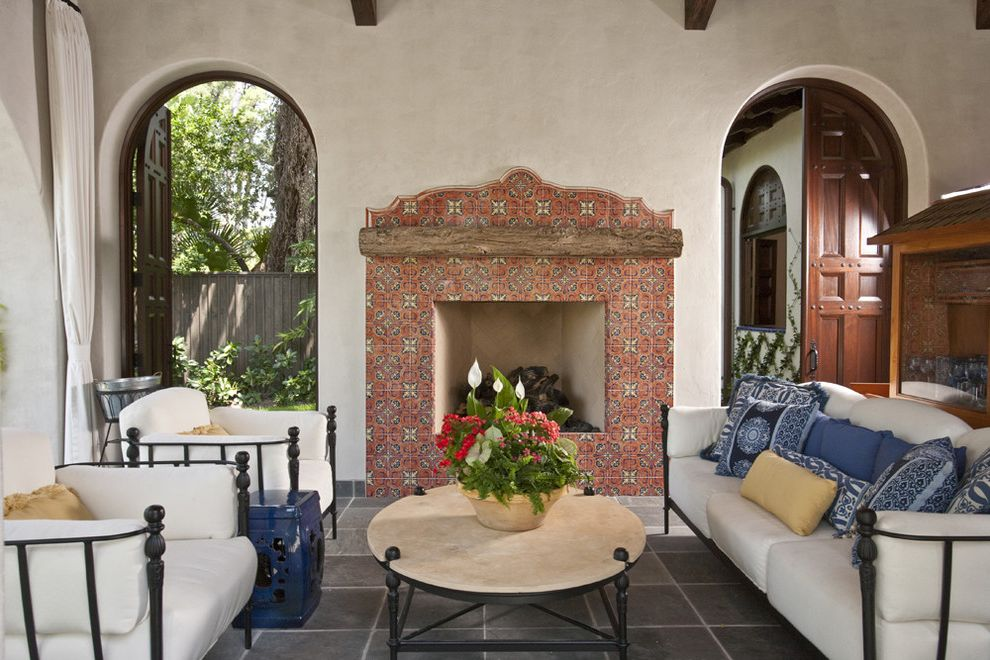 Baers Furniture Orlando with Southwestern Porch  and Accent Tile Archway Dark Floor Decorative Pillows Fireplace Mantel Metal Patio Furniture Outdoor Cushions Rustic Spanish Spanish Tile Throw Pillows Tile Fireplace Surround Tile Floor