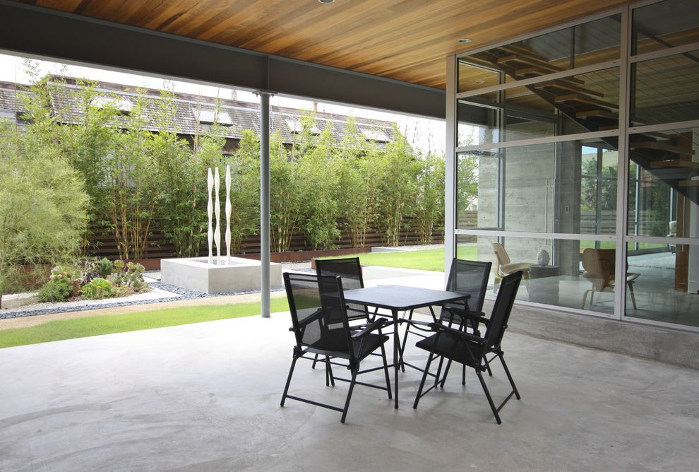 Bamboo Growth Rate with Modern Landscape  and Bamboo Black Cafe Table Concrete Covered Patio Lawn Metal Windows Sculpture Stones Water Feature Wood Ceiling