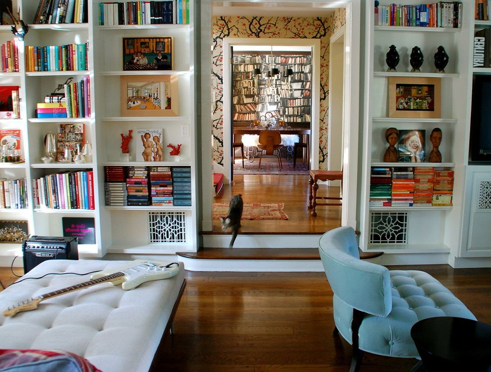 Baseboard Vent Covers with Eclectic Living Room  and Bookcase Bookshelves Built in Shelves Cat Eames Library Sunken Living Room Tufted Chair Wallcoverings Wallpaper Wood Flooring