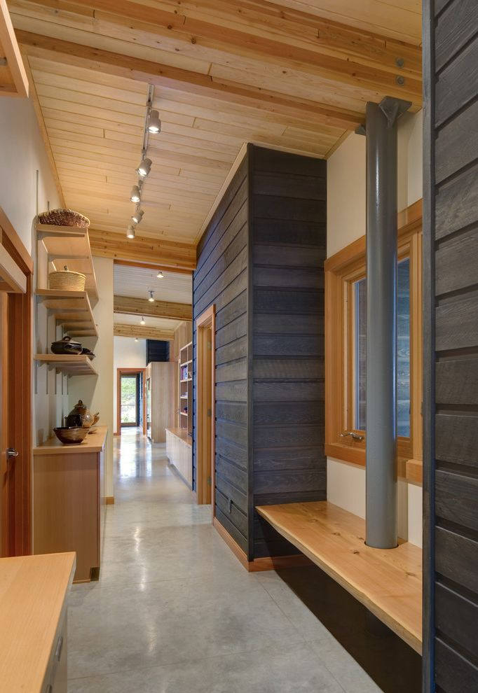 Bona Stain Colors with Rustic Hall  and Beams Built in Bench Concrete Floor Dark Stained Wood Knotty Pine Natural Wood Trim Open Shelving Polished Concrete Seattle Architect Slanted Ceiling Tongue and Groove Track Lighting Wood Ceiling