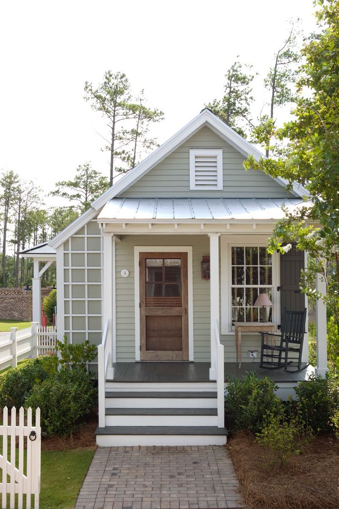 Buying a Short Sale House   Farmhouse Exterior Also Cabin Cottage Covered Entry Exposed Rafters Front Porch Gable Roof Guest House Lap Siding Louvered Vent Metal Roof Pavers Picket Fence Plants Rocking Chair Shutters Steps Window Wood Lattice