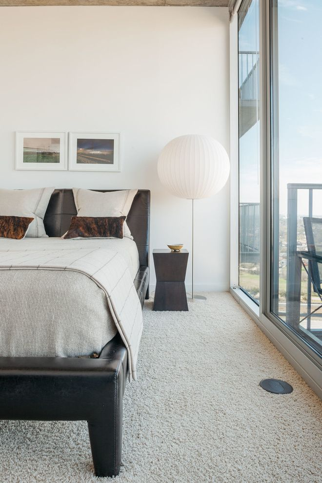 Carpet Repair Houston with Contemporary Bedroom  and Apartment Balcony Contemporary Globe Lamp Highrise Houston Interiordesign Interiors Leather Headboard Modern Natural Lighting Sliding Glass Door Smallspaces Texas
